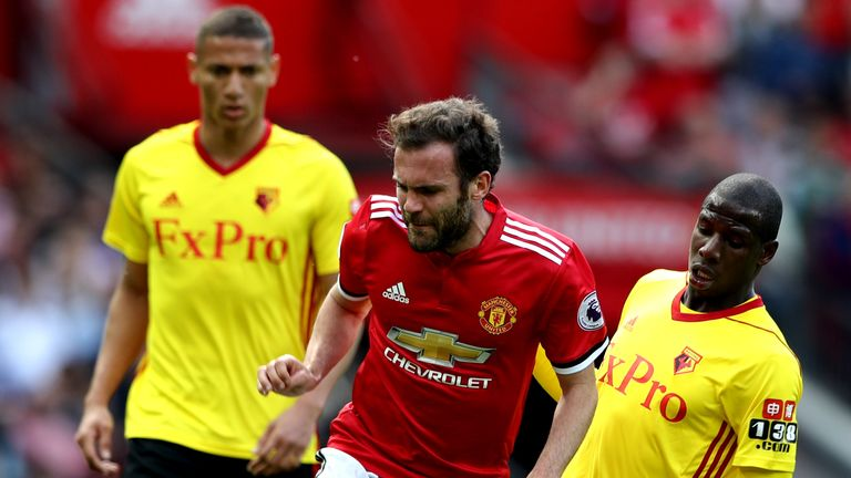 Juan Mata is tackled by Abdoulaye Doucoure