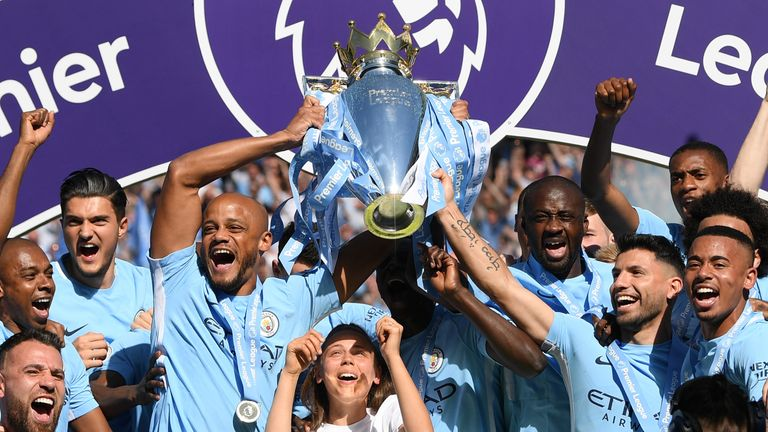 Vincent Kompany lifts the Premier League trophy as Manchester City are crowned Premier League champions at the Etihad