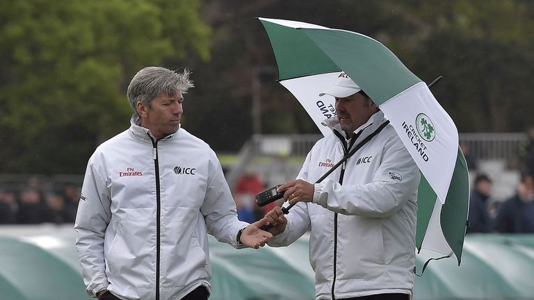 Umpires Nigel Long and Richard Illingworth inspect conditions at Malahide
