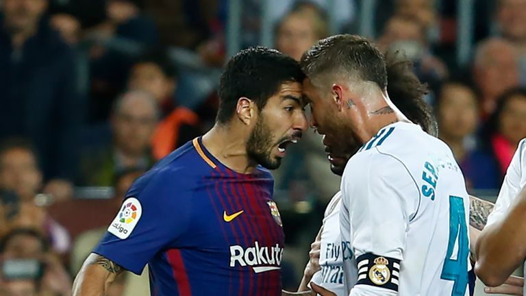 Luis Suarez clashes with Sergio Ramos