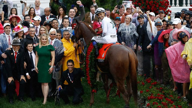 Jockey Mike Smith poses for a photo in the winner's circle atop of Justify #7 after winning the 144th running of the Kentucky Derby