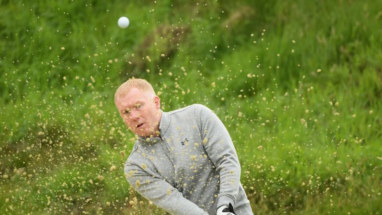Paul Scholes plays a bunker shot during the pro-am at the BMW PGA Championship at Wentworth