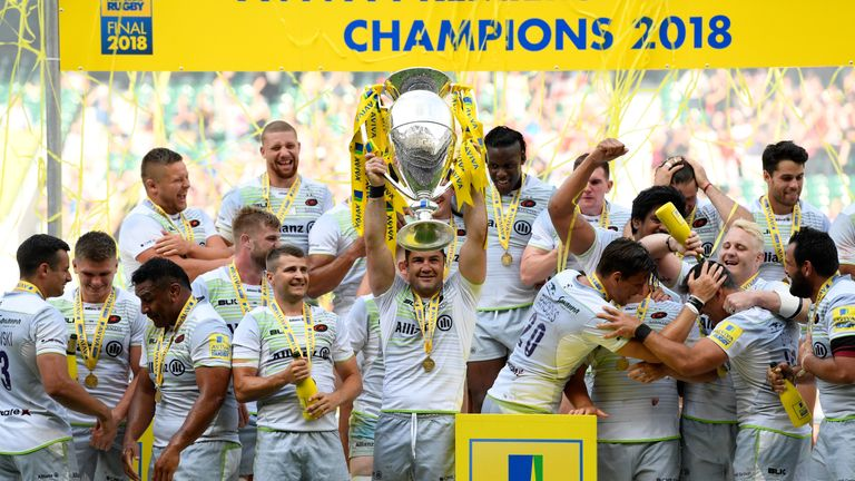 Brad Barritt of Saracens lifts the Aviva Premiership trophy following his side's victory during the Final v Exeter Chiefs at Twickenham Stadium