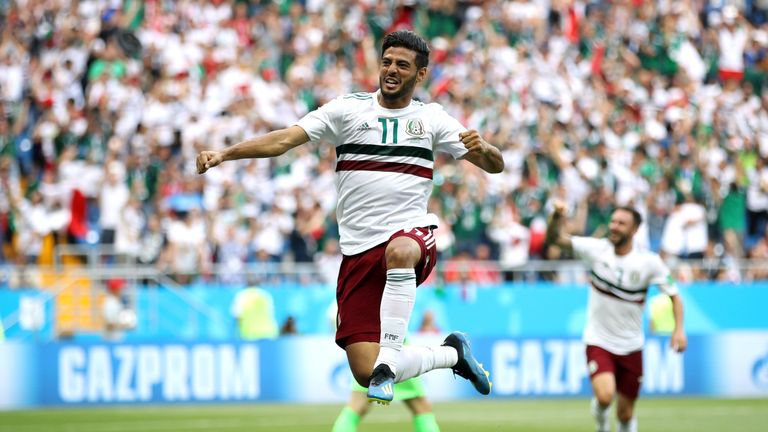 Carlos Vela celebrates after scoring a penalty for Mexico against South Korea