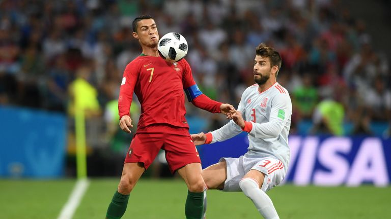 Ronaldo is challenged by Gerard Pique