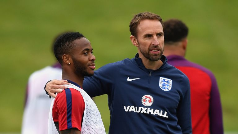 England manager Gareth Southgate with Sterling during training