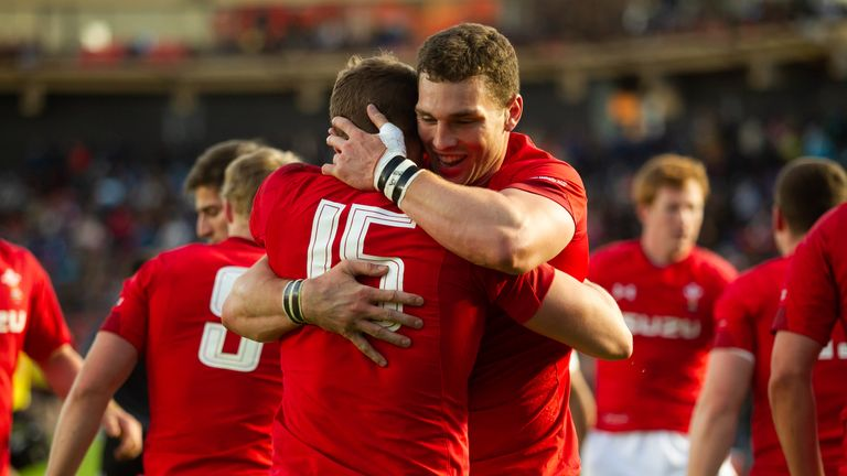 Hallam Amos (L) and George North celebrate a Wales try