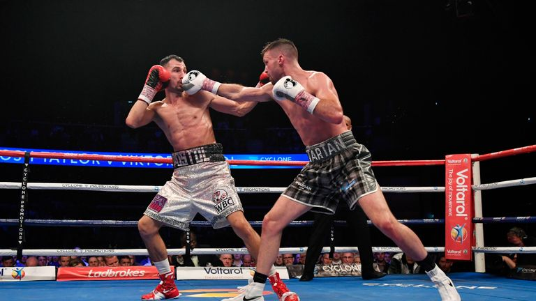 Josh Taylor (right) lands a blow on Viktor Postol in Glasgow