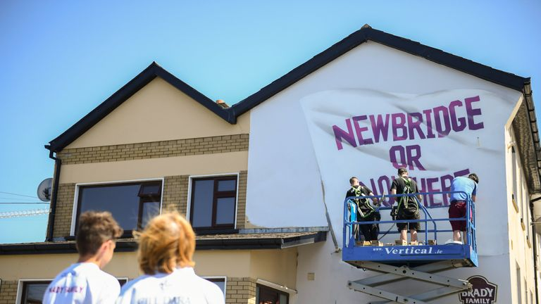 Kildare supporters watch a mural being painted outside St Conleth's Park, Newbridge