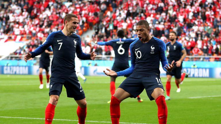 Kylian Mbappe celebrates with team-mate Antoine Griezmann