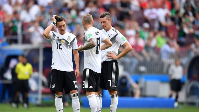 Mesut Ozil, Toni Kroos and Julian Draxler in discussion prior to a Germany free kick