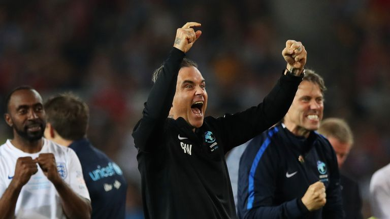 UK Pop Star Robbie Williams Kicks Off World Cup With His Finger