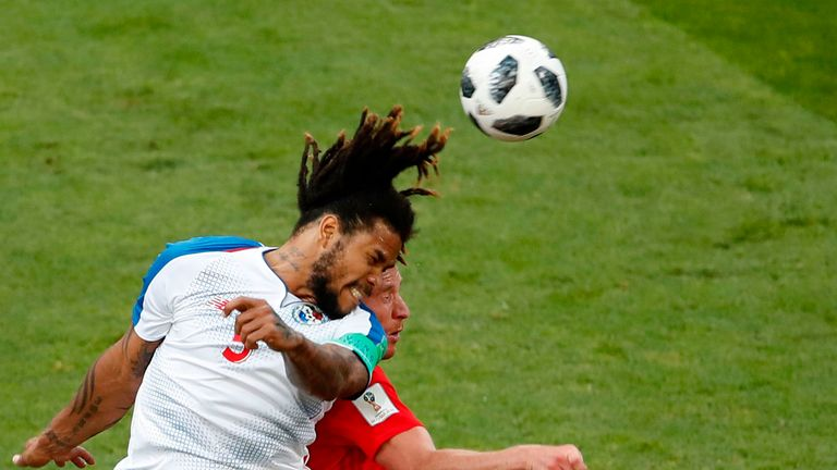Panama's Roman Torres wins an aerial battle against Belgium