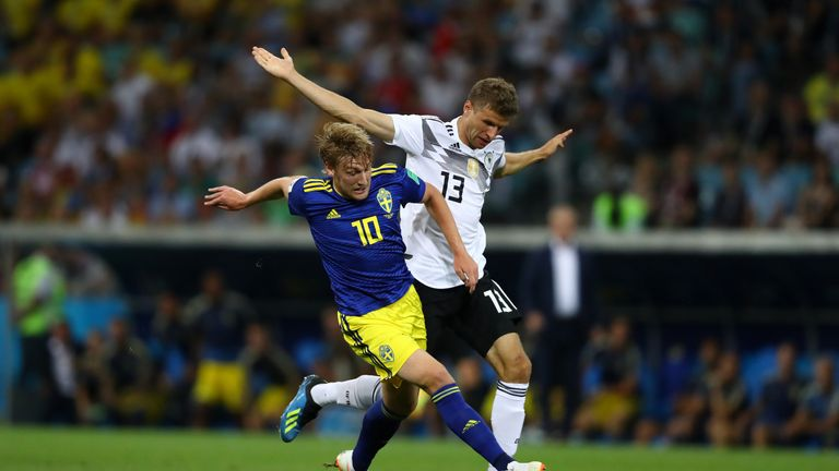 Thomas Muller challenges Emil Forsberg in the first half