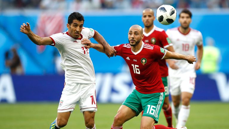 Vahid Amiri and Noureddine Amrabat in action during the 2018 World Cup Group B match between Morocco and Iran