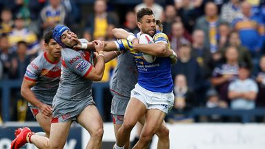 Joel Moon is tackled by Benjamin Jullien and Lewis Tierney during the Rhinos' defeat to the Dragons