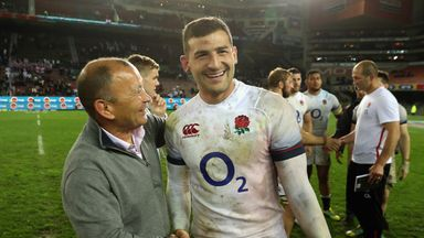 England head coach Eddie Jones congratulates wing Jonny May on another eye-catching display.