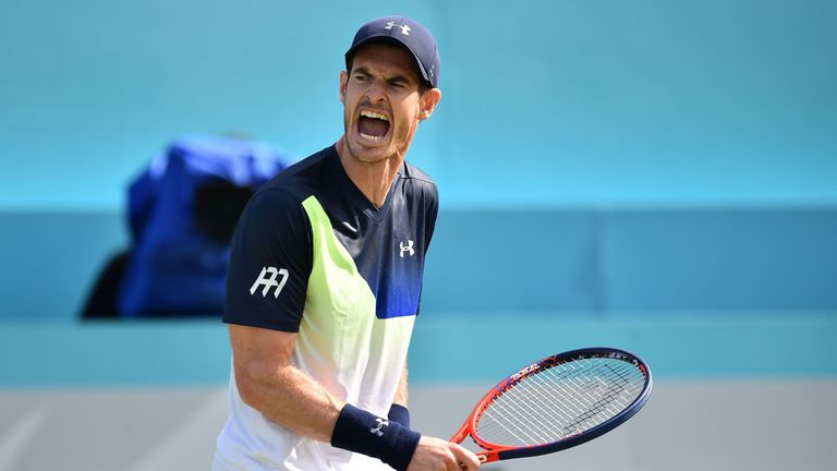 Britain's Andy Murray reacts to Australia's Nick Kyrgios during their first round men's singles match at the ATP Queen's Club Championships tennis tournament in west London on June 19, 2018