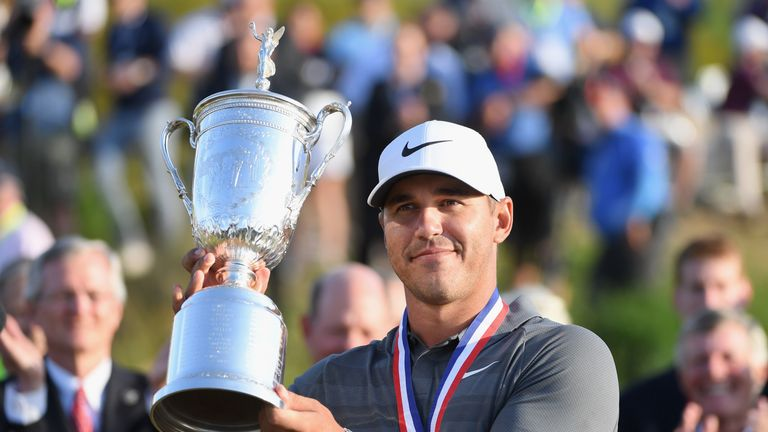 Brooks Koepka with the trophy during the final round of the 2018 U.S. Open at Shinnecock Hills Golf Club on June 17, 2018 in Southampton, New York.