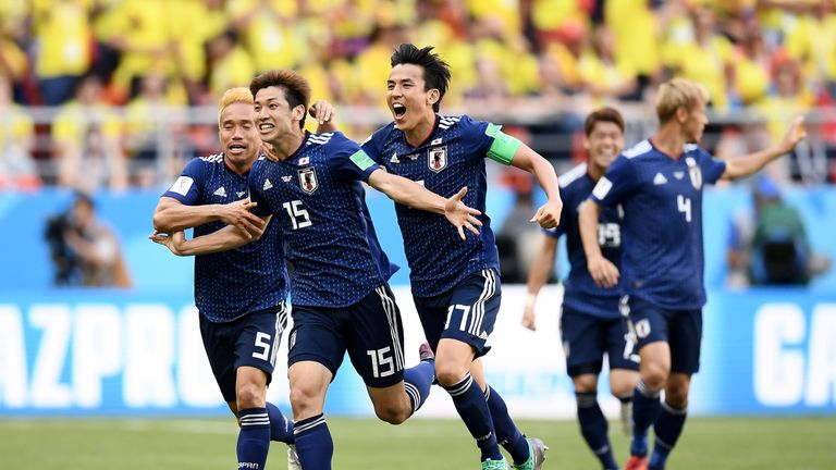 Japan celebrate during the 2018 FIFA World Cup Russia group H match against Colombia at Mordovia Arena on June 19, 2018 in Saransk, Russia