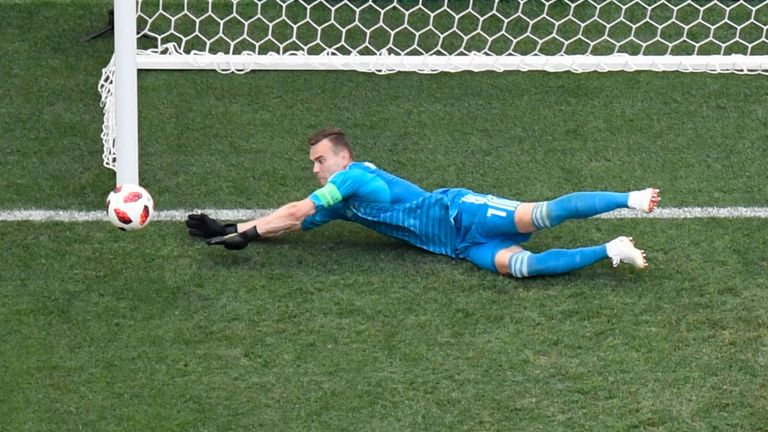 Igor Akinfeev denies Spain on day 18 of the World Cup