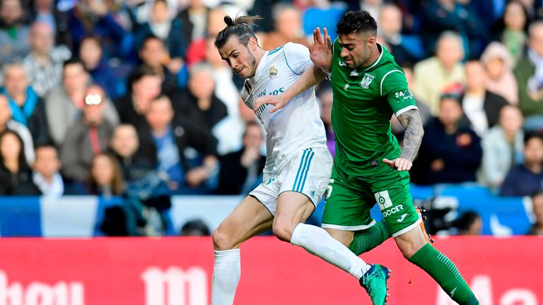 Diego Rico competes for the ball with Real Madrid's Gareth Bale
