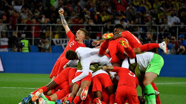 England's players celebrate winning the penalty shootout against Colombia in the last 16