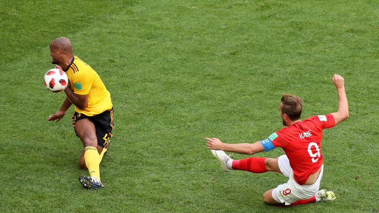 Kane drags a shot wide under pressure from Vincent Kompany