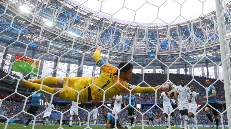 Hugo Lloris saves from a Martin Caceres header