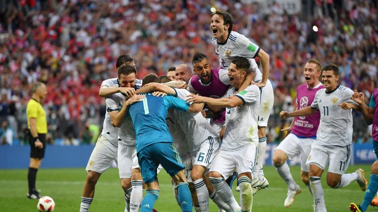 Russia players celebrate after beating Spain on penalties