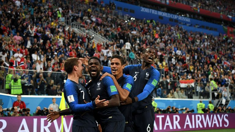 Antoine Griezmann celebrates with Samuel Umtiti after setting him up for France's winning goal