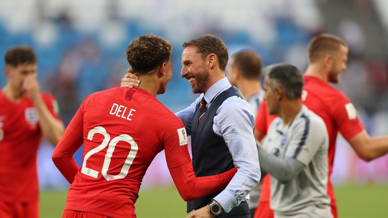 Gareth Southgate and Alli share a hug after quarter-final win