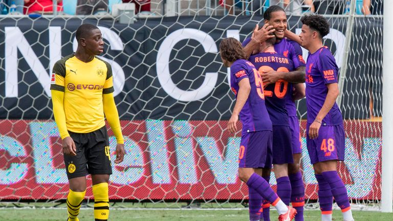 Virgil van Dijk celebrates scoring against Borussia Dortmund