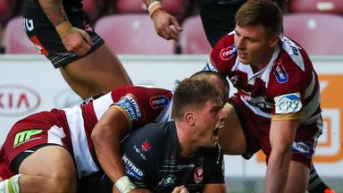 St Helens' Morgan Knowles celebrates his try