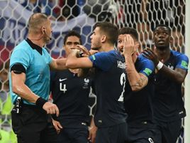 Nestor Pitana is surrounded by France players in the 38th minute of the World Cup final