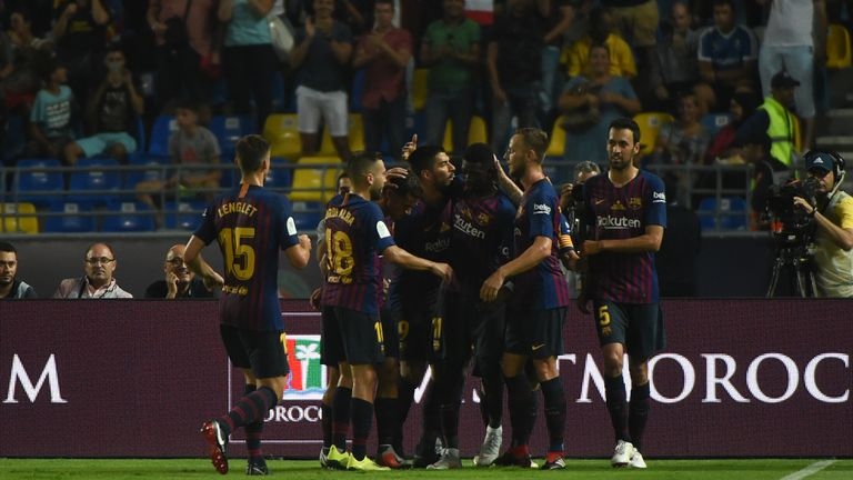 Dembele is mobbed by team-mates after putting Barcelona 2-1 ahead