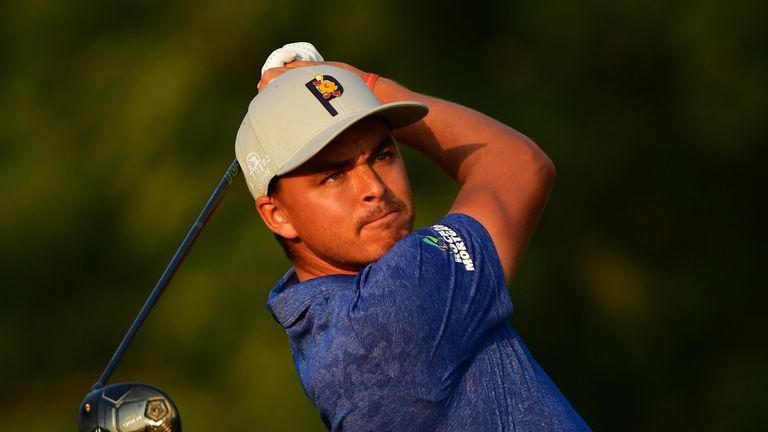 Rickie Fowler, chasing a first major triumph, sits two back at the midway stage