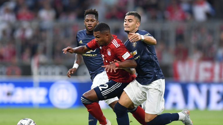 Manchester United's Brazilian Fred, Bayern Munich midfielder Serge Gnabry and United midfielder Andreas Pereira vie for the ball