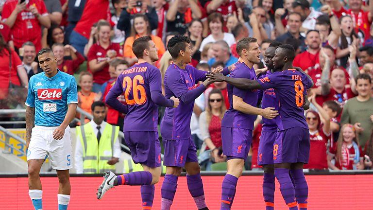 James Milner celebrates scoring against Napoli