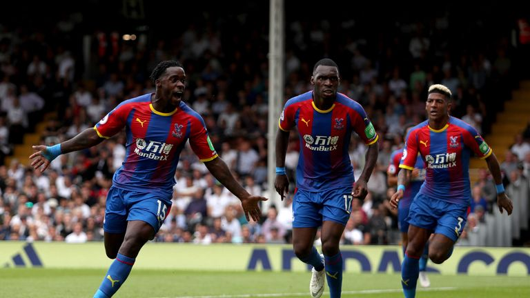 Jeffrey Schlupp wheels away after scoring the first goal of the game