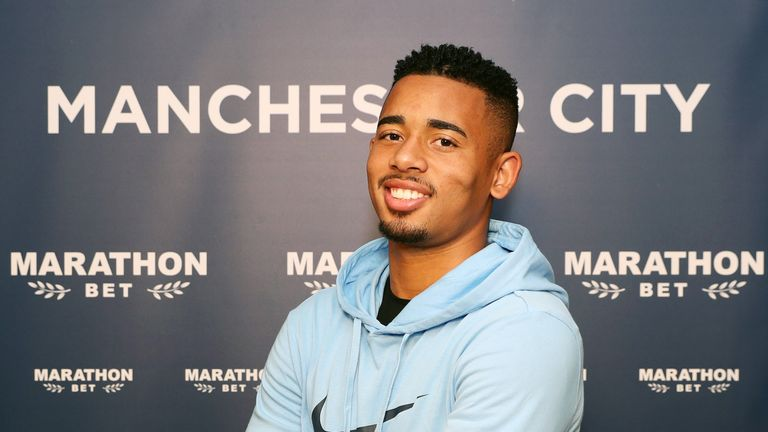 Gabriel Jesus poses after signing a contract extension at Manchester City