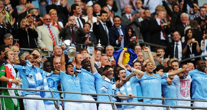 Captain Tevez leads the celebrations as Manchester City lift the FA Cup