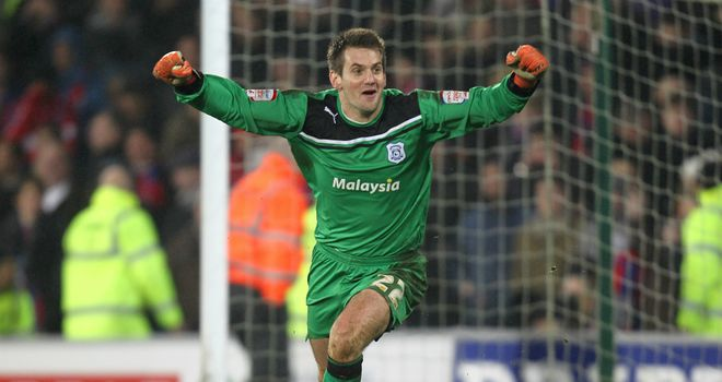 Tom Heaton: The Cardiff goalkeeper celebrates after seeing his side reach Wembley