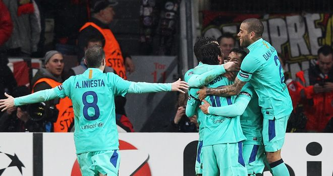 Barcelona players celebrate the opening goal from Alexi Sanchez, his first in the Champions League
