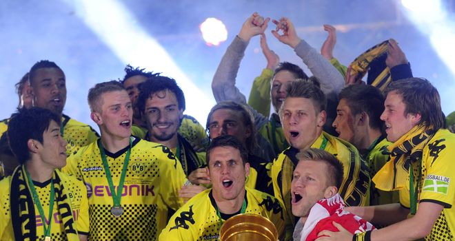 Borussia Dortmund celebrate the first league and cup double in their history