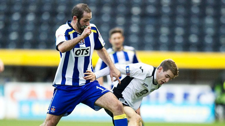 Gary Harkins: Battles for the ball with Carmichael