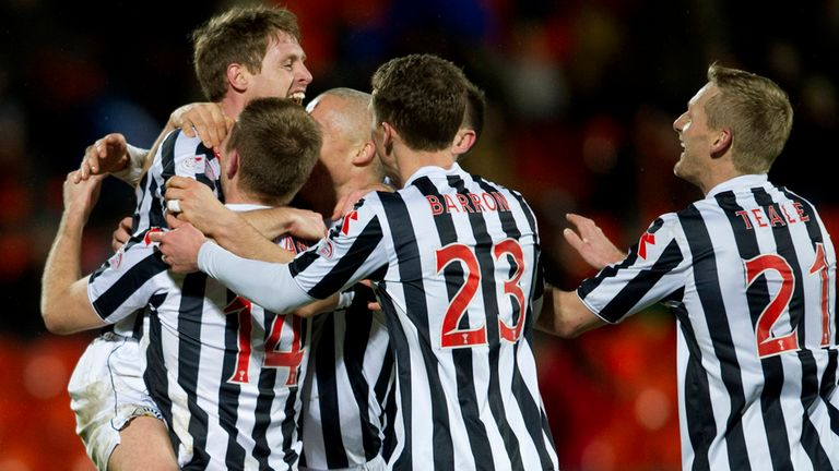 David van Zanten: Mobbed after rare goal sealed victory over Dundee United.