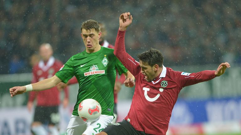 Nils Petersen (left) challenges for the ball