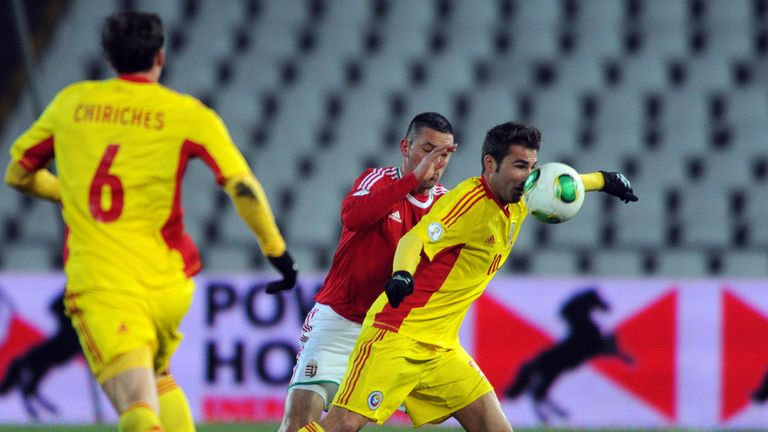 Battle: Adrian Mutu and Norbert Meszaros vie for the ball in 2-2 draw