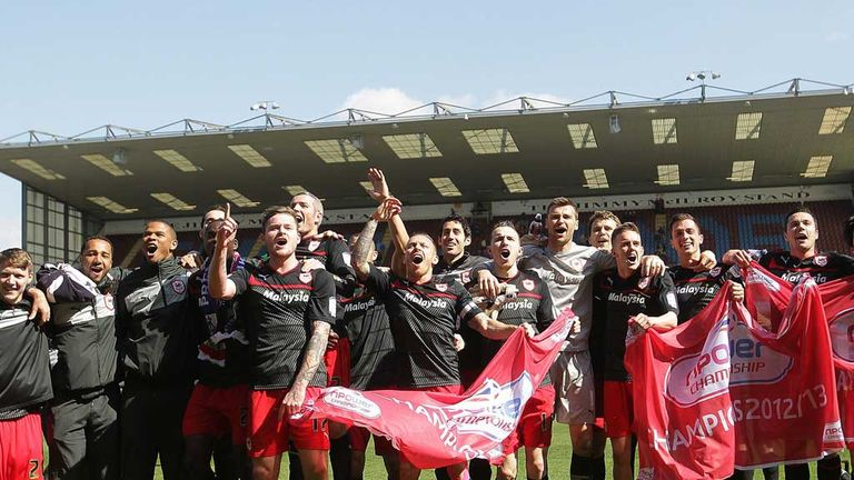 The Cardiff players celebrate clinching the Championship title at Burnley